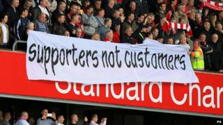 Supporters hold up banner