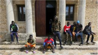 Adolescent migrants are seen at the courtyard of an immigration centre in Caltagirone, Sicily, 18 March 2015