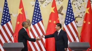 US President Barack Obama and Chinese President Xi Jinping shake hands