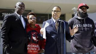 Attorney Anthony D. Gray speaks as Michael Brown's parents, Lesley McSpadden, second from left, and Michael Brown Sr., right, listen along with attorney Benjamin L. Crump, left, during a news conference 23 April 2015