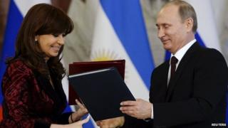 Russian President Vladimir Putin and Argentina's President Cristina Fernandez de Kirchner exchange documents during signing ceremony at the Kremlin. 23 April 2015