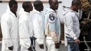 Migrants disembarking in Sicily