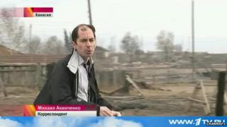 Russian journalist Mikhail Akinchenko does piece to camera in video report on wildfires in the Russian republic of Khakassia in April 2015