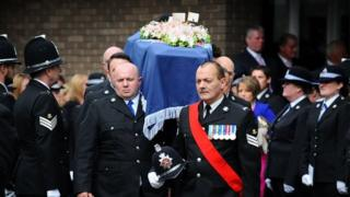 Sgt Louise Lucas's coffin is carried into the service