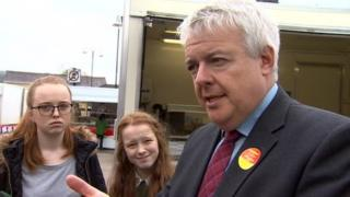Carwyn Jones talking to pupils in Ammanford