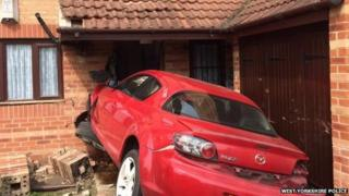 A Mazda stuck in a house in Leeds