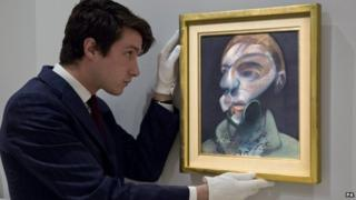 Art handler with Self-Portrait (1975) by Francis Bacon