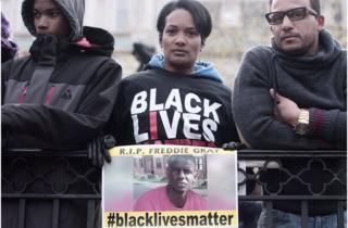 Woman holding #blacklivesmatter sign