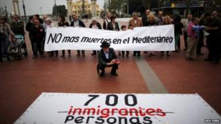 """People hold a banner reading """"No more deaths in the Mediterranean"""" during a protest against the current immigration policy of the European Union in Malaga"""