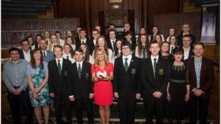 Grosvenor Grammar School choir with their teachers and the competition judges