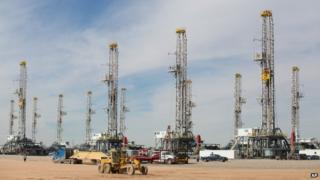 "A number of idle oil drilling rigs in Helmerich ^ Payne International Drilling Company""s yard in Ector County, Texas"