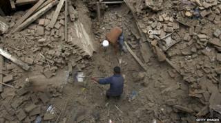 Rescuers using shovels