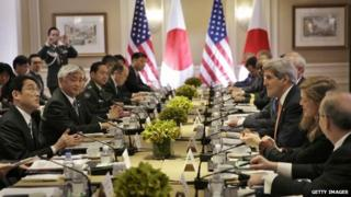 Japanese Foreign Minister Fumio Kishida, left, and Defense Minister Gen Nakatani, second from left, attend a meeting with United States Secretary of State John Kerry, third from right, and Secretary of Defense Ashton Carter, not visible April 27, 2015 in New York City