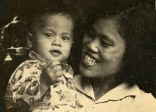 Ly as a baby with her mother Quy