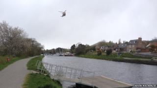 Coastguard helicopter over Caledonian Canal