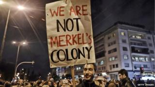 """We are not Merkel's colony"" banner"