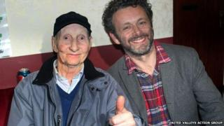 Michael Sheen and Dave Green together during shooting of a documentary