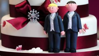 Same-sex marriage figures on wedding cake
