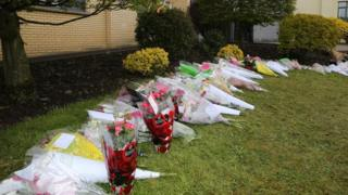 Floral tributes at Dominican College