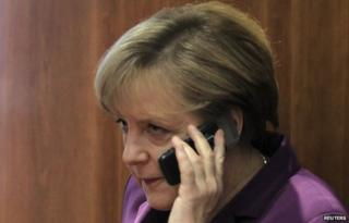 File pic of Angela Merkel with mobile phone