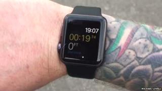 Apple Watch on a tattooed wrist