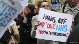 A woman protests against NHS privatisation in London in May 2013