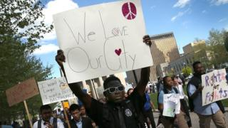 Students from Digital Harbor High School chant 'We Love Baltimore' as they march outside City Hall April 29, 2015 in Baltimore, Maryland