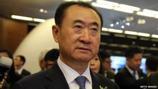 Wang Jianlin arrives at the Hong Kong stock exchange on 23 December, 2014