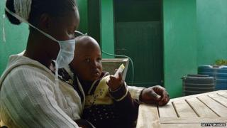 Mother and young sun in a health clinic in Kenya
