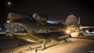 Chinook being loaded onto a plane at Brize Norton