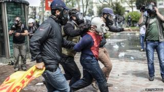 Turkish police detain a protester