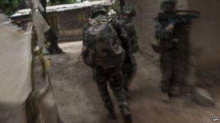 French troops patrol to secure an area after exchanges of gunfire during a disarmament operation in the Combattant neighbourhood near the airport of Bangui, on December 9, 2013.