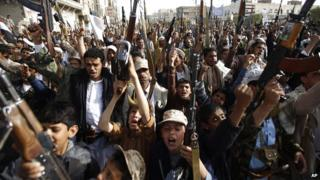 Houthi rebels hold up their weapons to denounce the Saudi-led airstrikes in Sanaa, Yemen, Monday, April 27, 2015