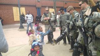 Baltimore children play with National Gaurdsmen