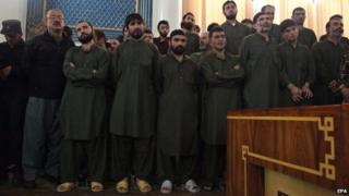 Unidentified suspects attend their primary court trial in Kabul, Afghanistan