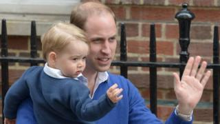"The Duke of Cambridge waves to supporters with his son Prince George as he arrives at St Mary""s Hospital in London, after the birth of his daughter"