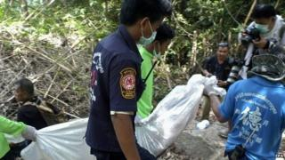 Thai rescue workers carry a recovered body