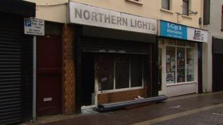 The shutters of the Northern Lights shop were forced open and a fire was started inside which caused damage to the property