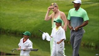 Tiger Woods and Lindsey Vonn during golf competition in Augusta, Georgia. 8 April 2015