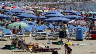 A Benidorm beach busy with tourists