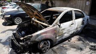 Car damaged by suicide bomb explosion in Damascus, Syria (4 May 2015)