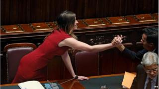 Italian reform Minister Maria Elena Boschi celebrates in parliament after the passage of the government's electoral reform, 4 May 2015