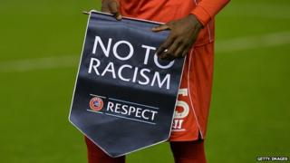 Mario Balotelli holds a 'Respect' anti-racism banner