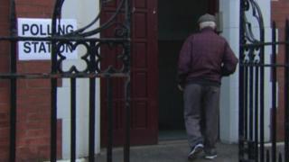 Man walking in to polling station