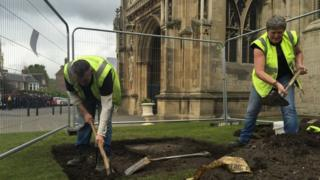 Workmen outside Gloucester Cathedral