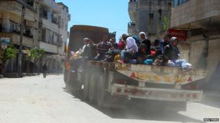 Residents flee Jisr al-Shughour town after rebels took control of the area on 25 April, 2015.