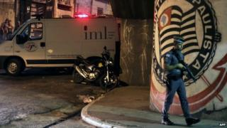 """A policeman stands guard outside the Corinthians fans """"Hall 9"""" headquarters after the shooting"""