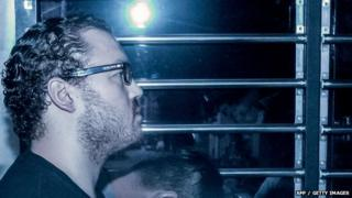British banker Rurik Jutting accused of the murders of two Indonesian women, sits in a prison van as he arrives at the eastern court in Hong Kong 8 May 2015