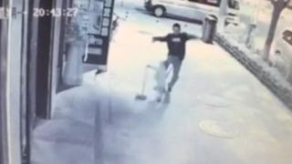 CCTV footage shows man brutally beating young boy in street, Yan'an city, Shaanxi province, China - 04 May 2015