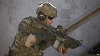 Prince Harry with rifle